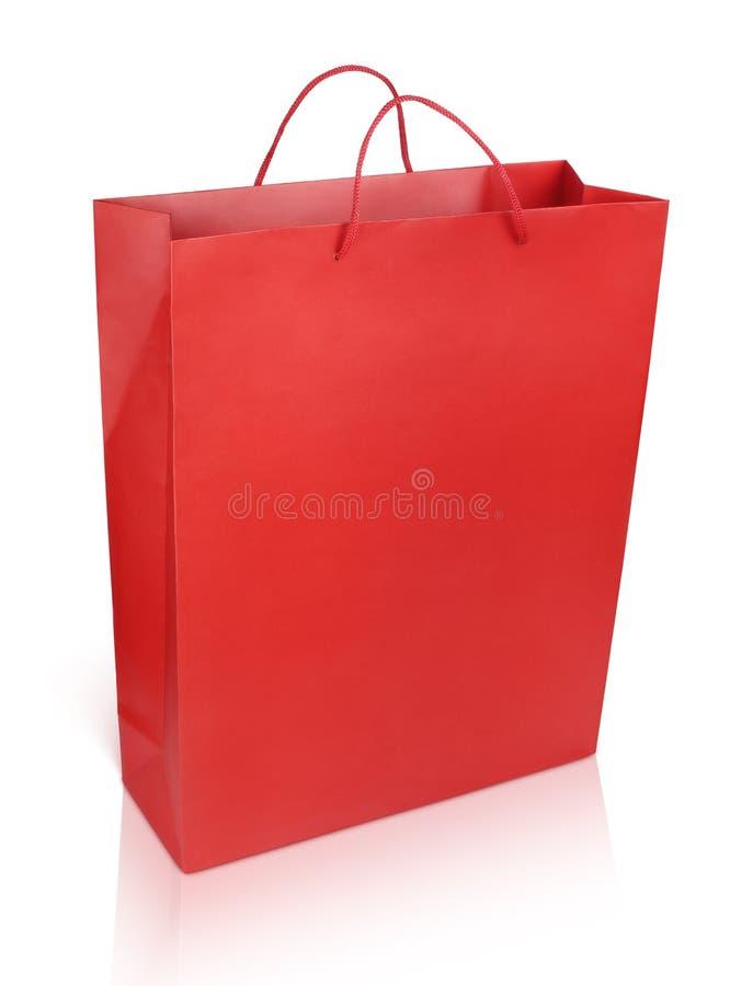 Bolso de compras rojo en blanco foto de archivo libre de regalías