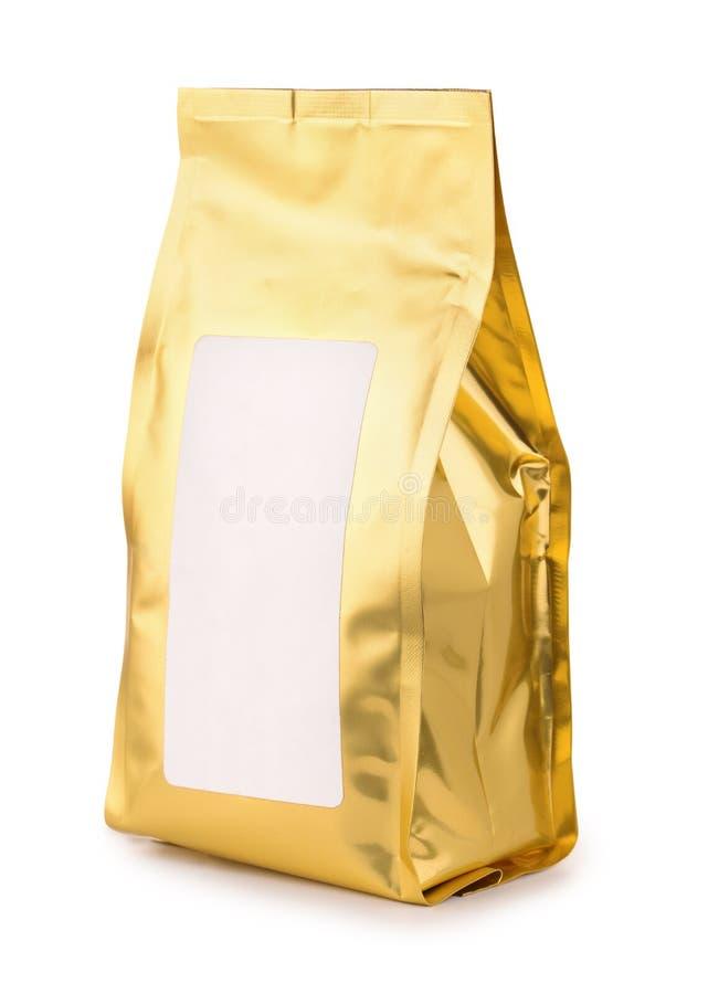 Bolso de oro de la comida de la hoja con la etiqueta en blanco imagenes de archivo