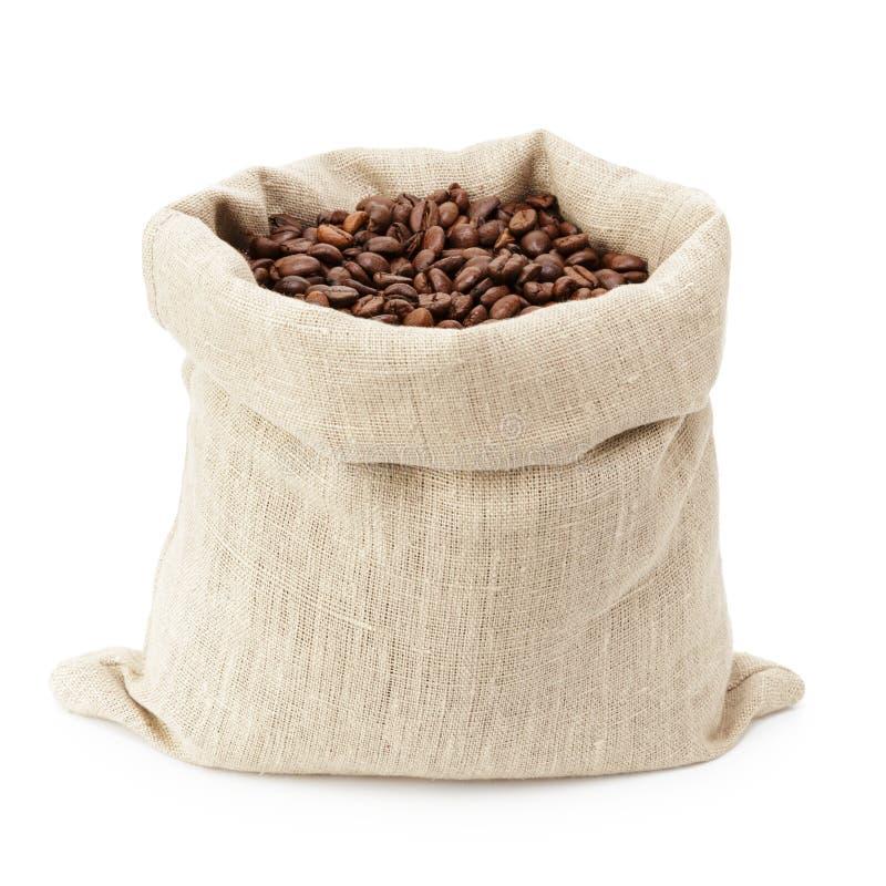 Bolso del saco por completo de los granos de café roated fotografía de archivo