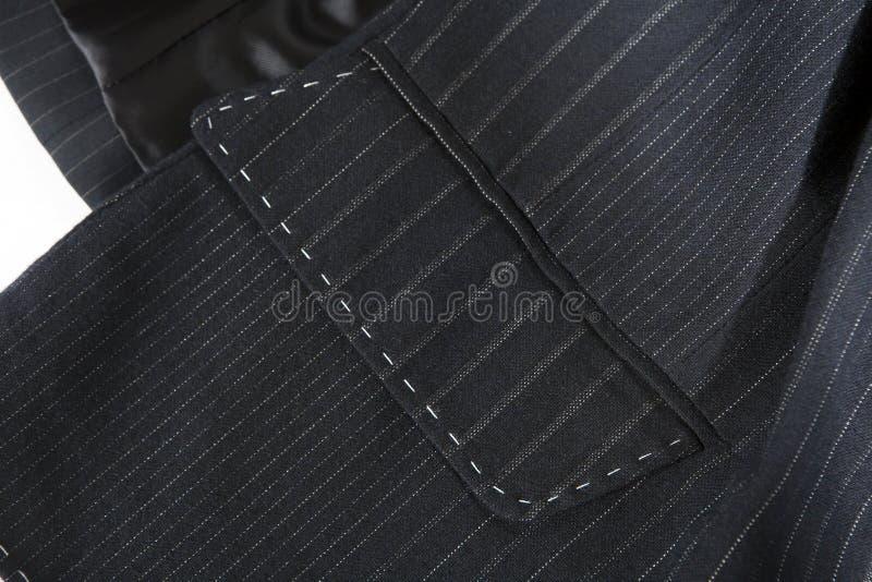 Bolso do terno com emendas Um revestimento cinzento com uma tira de boas lãs imagens de stock royalty free