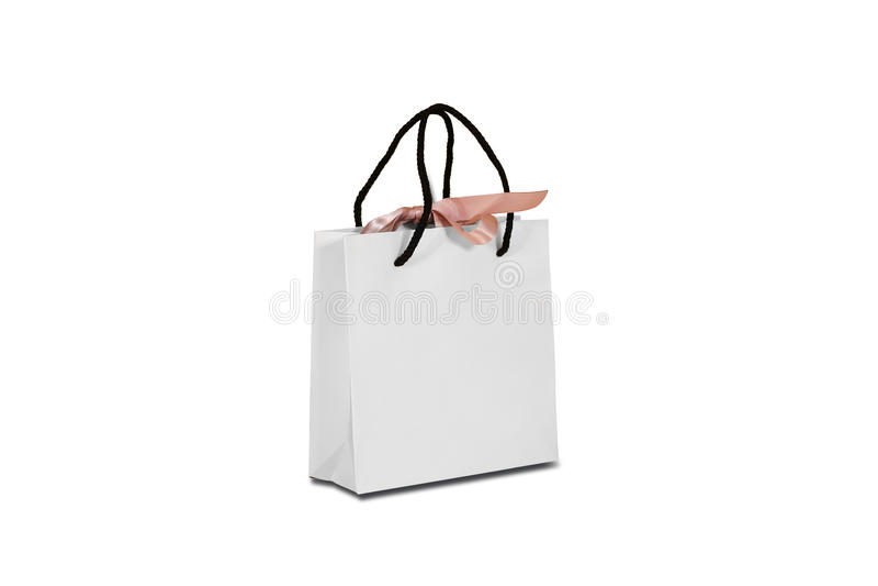 Bolso en blanco del regalo del Libro Blanco con una mofa del arco que se levanta en una madera fotografía de archivo