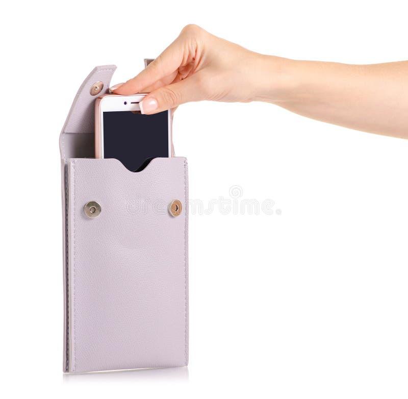 Bolso femenino para el smartphone del teléfono móvil a disposición imagen de archivo