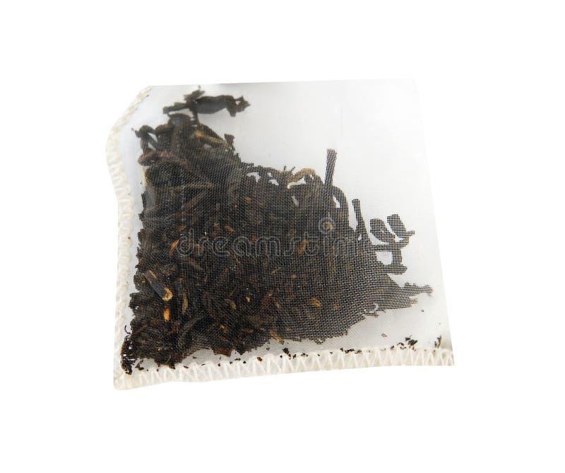 Bolso llenado de té negro orgánico imagenes de archivo