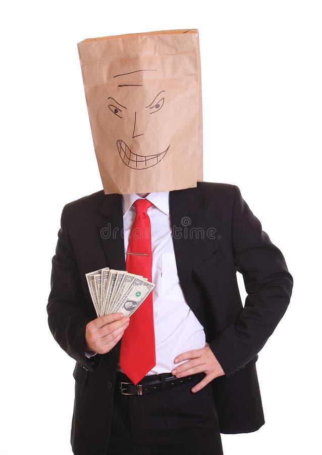 Bolso malvado del hombre de negocios con el dinero fotos de archivo