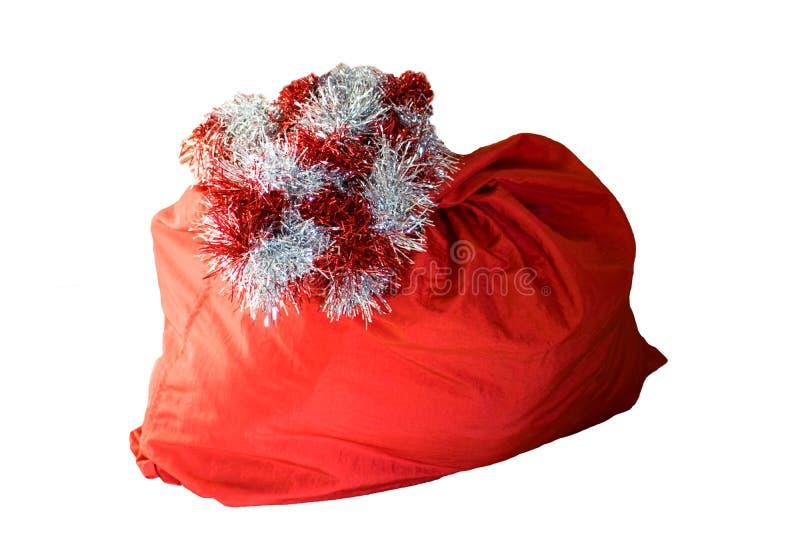 Bolso rojo de Santa Claus, aislado en el fondo blanco fotografía de archivo libre de regalías