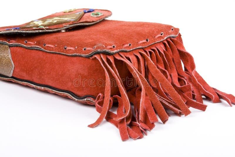 Bolso rojo del ante con la franja fotografía de archivo libre de regalías