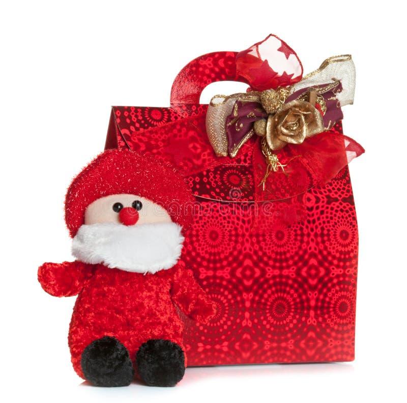 Bolso rojo del regalo con la marioneta de Santa Claus imagen de archivo