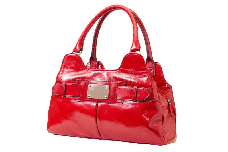 Bolso rojo femenino de la patente imagenes de archivo