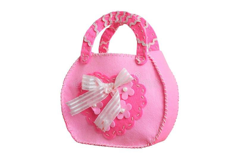 Bolso rosado del bebé cosido de los pedazos aislados en blanco imágenes de archivo libres de regalías