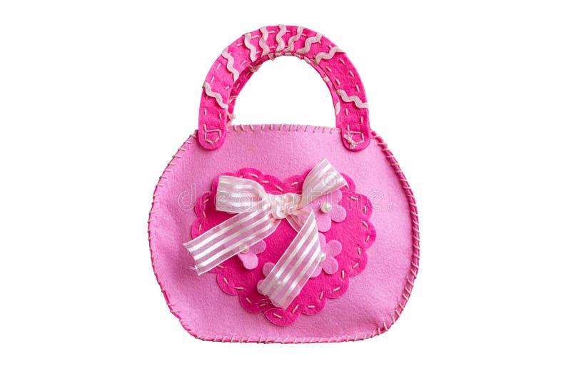 Bolso rosado del beb? cosido de los pedazos aislados en el fondo blanco imagen de archivo