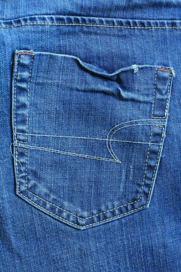 Bolso traseiro da calças de ganga fêmea fotografia de stock