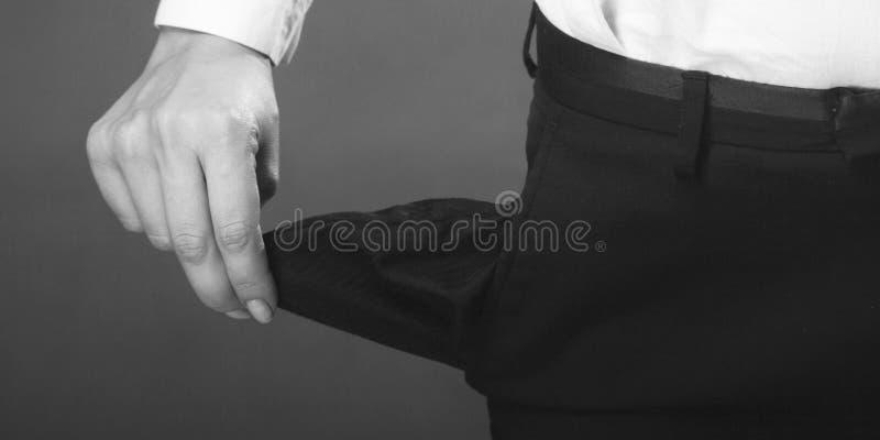 Bolso vazio como um símbolo da falta de dinheiro fotografia de stock