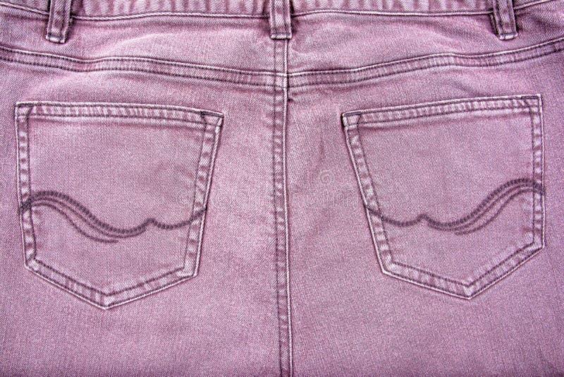 Bolsos da parte traseira de brim de Brown com teste padrão fotos de stock royalty free