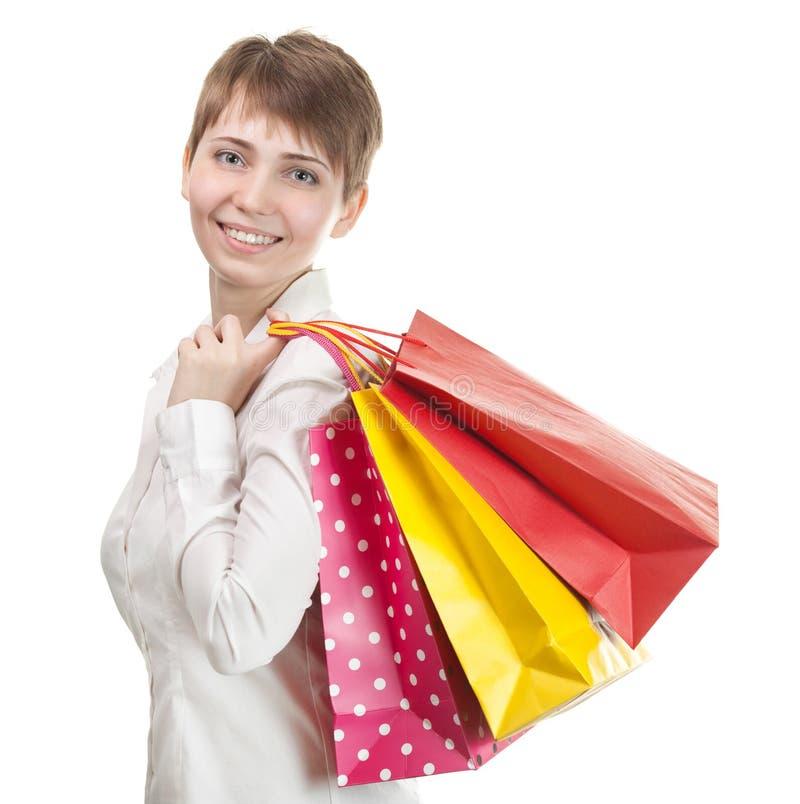 Bolsos de compras felices de la explotación agrícola de la mujer fotos de archivo