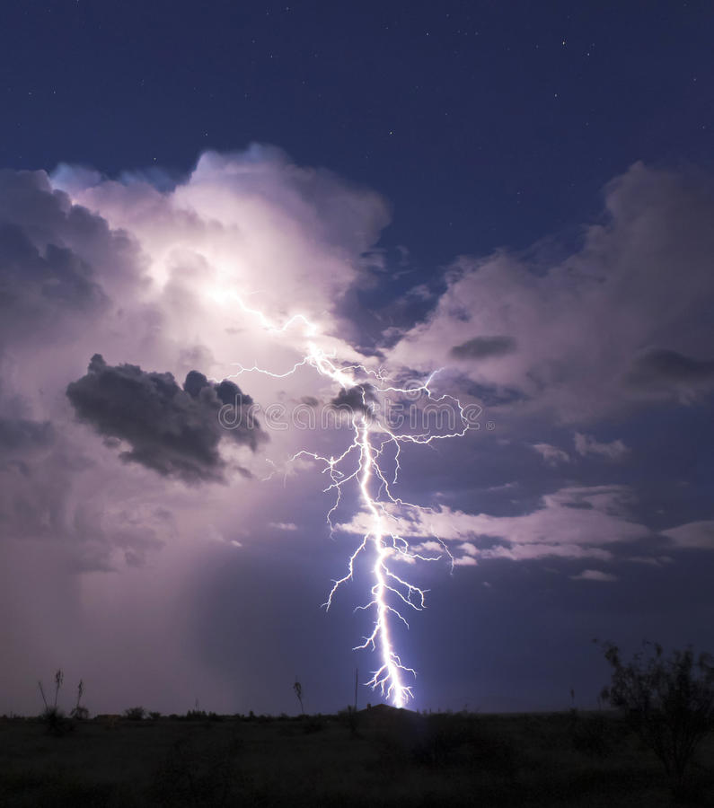 A Bolt of Lightning in the Desert Night stock photo