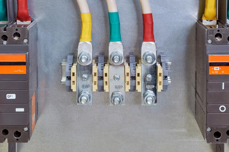Through bolt terminals with cables connected to them and circuit breakers stock photos