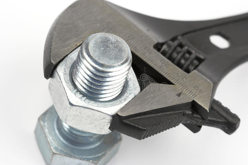 Bolt and wrench. Close up shallow dof royalty free stock photo