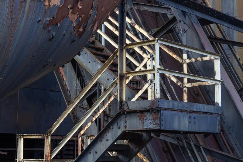 Bolted metal Bolted metal industrial stairway, peeled paint and rusted  stairway, peeled paint and rusted metal, horizontal aspect. Bolted metal industrial stock photo