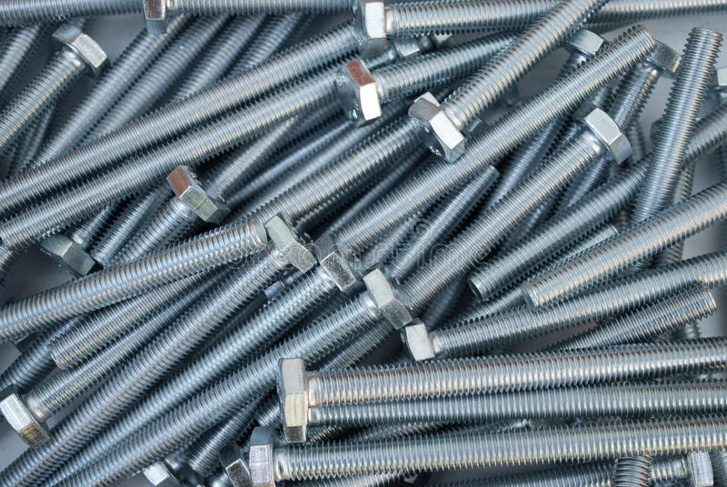 Bolts background. Background of disintegrating in disarray bolts stock photography