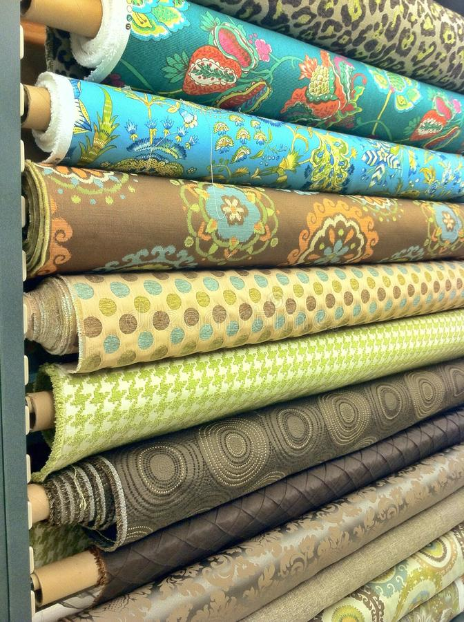 Bolts of fabric. Long bolts of fabric in a craft fabric material store manufactured for sewing and crafting for curtains furniture covers with pretty print in royalty free stock photography