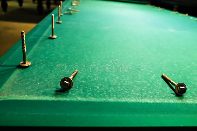 The bolts are on the felt pool table royalty free stock photography
