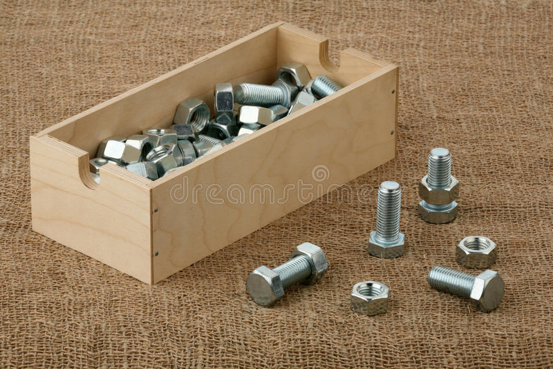 Bolts and nuts. And a plywood box stock photos