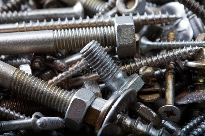 Bolts and nuts of different sizes. Collection of metal bolts and nuts of different sizes stock photography