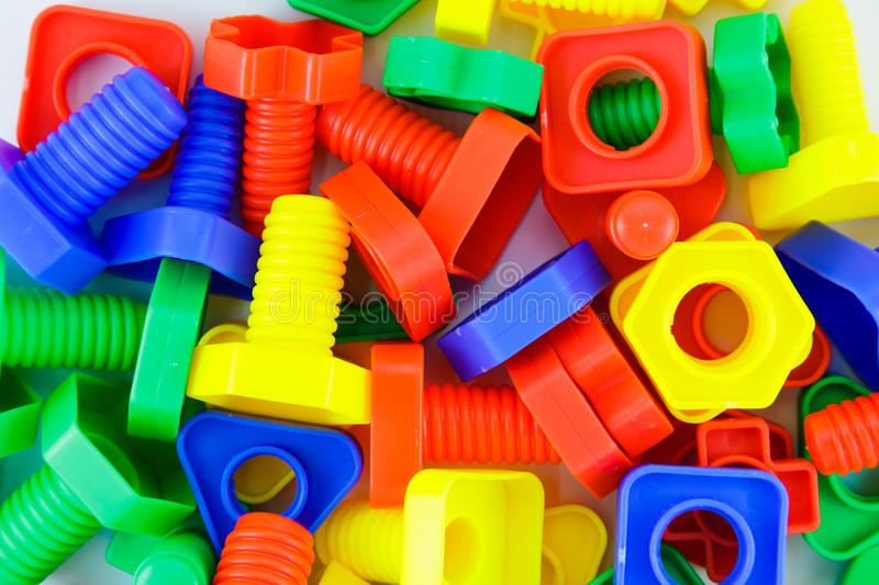 Bolts and nuts toy. Colorful plastic toy background, bolts and nuts royalty free stock images