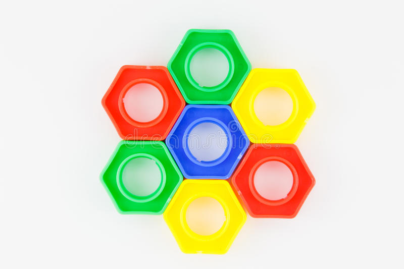 Bolts and nuts toy. Colorful plastic toy, bolts and nuts on a white background royalty free stock images
