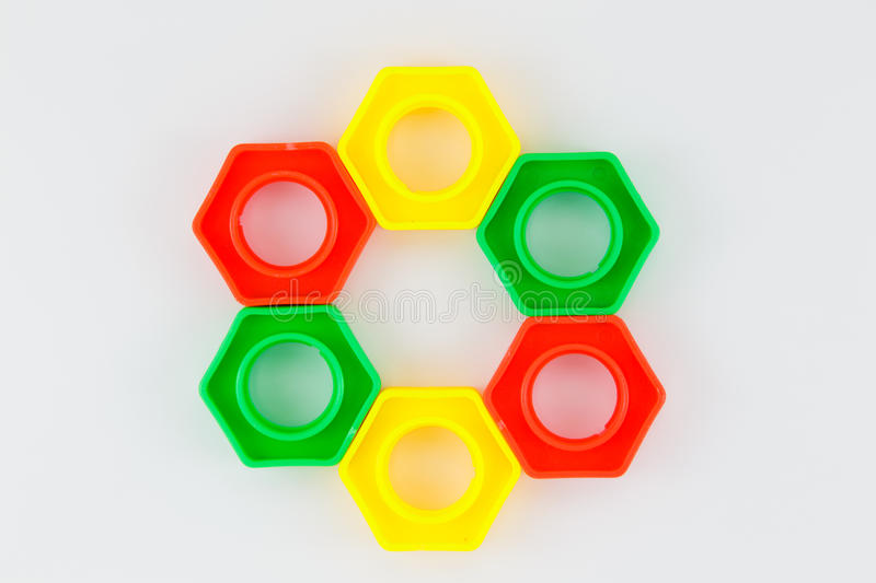 Bolts and nuts toy. Colorful plastic toy, bolts and nuts on a white background stock images