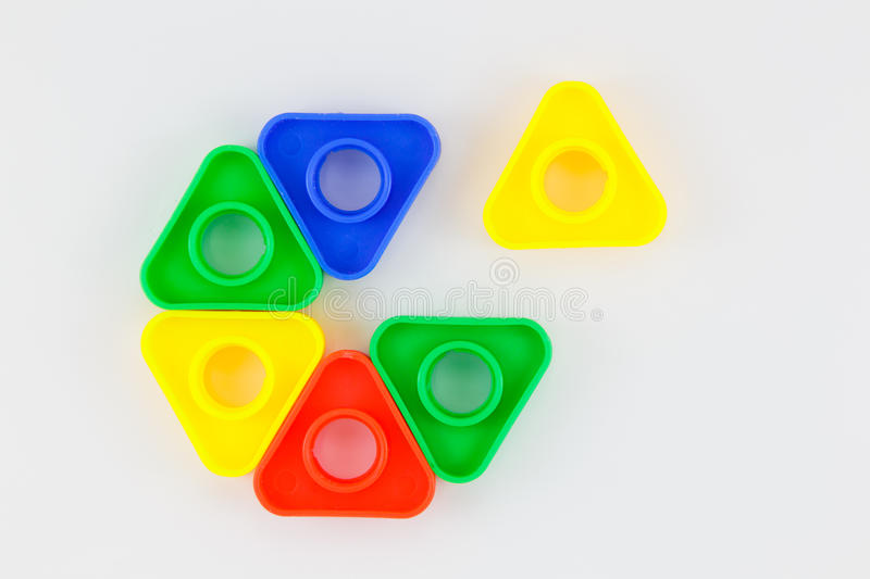 Bolts and nuts toy. Colorful plastic toy, bolts and nuts on a white background royalty free stock image