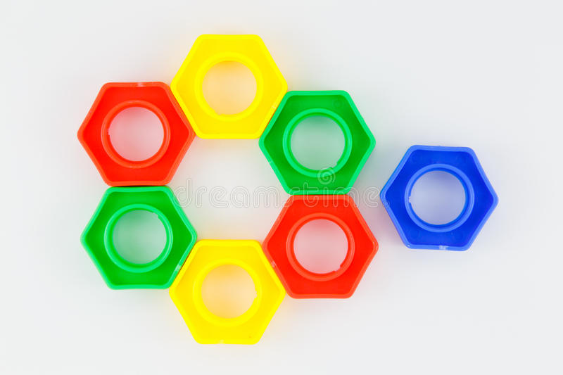 Bolts and nuts toy. Colorful plastic toy, bolts and nuts on a white background stock photos