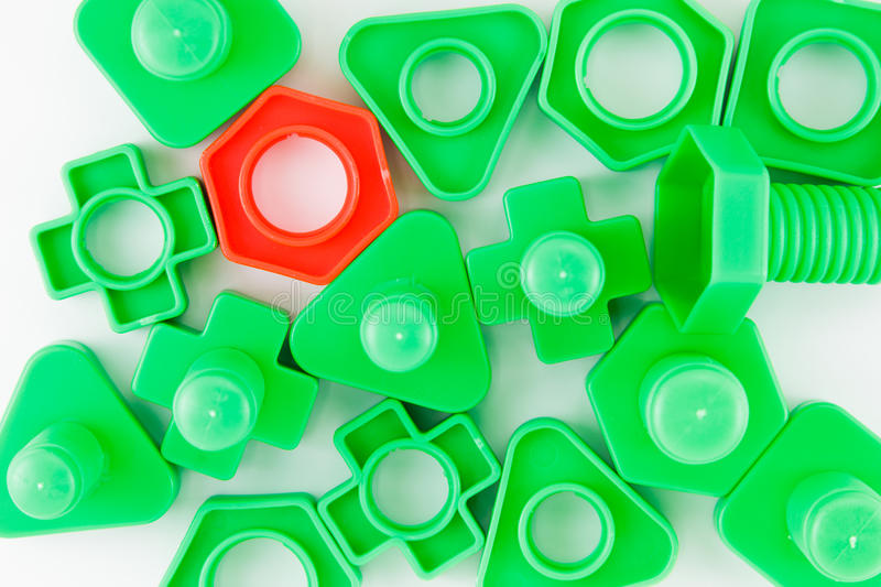 Bolts and nuts toy. Colorful plastic toy, bolts and nuts on a white background royalty free stock photography