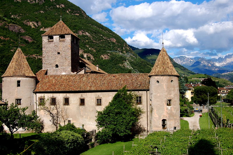Bolzano, Italy: Feudal Castello Mareccio. The feudal Castello Mareccio with its enclosing wall, round towers capped with conical roofs, and giant keep surrounded royalty free stock images