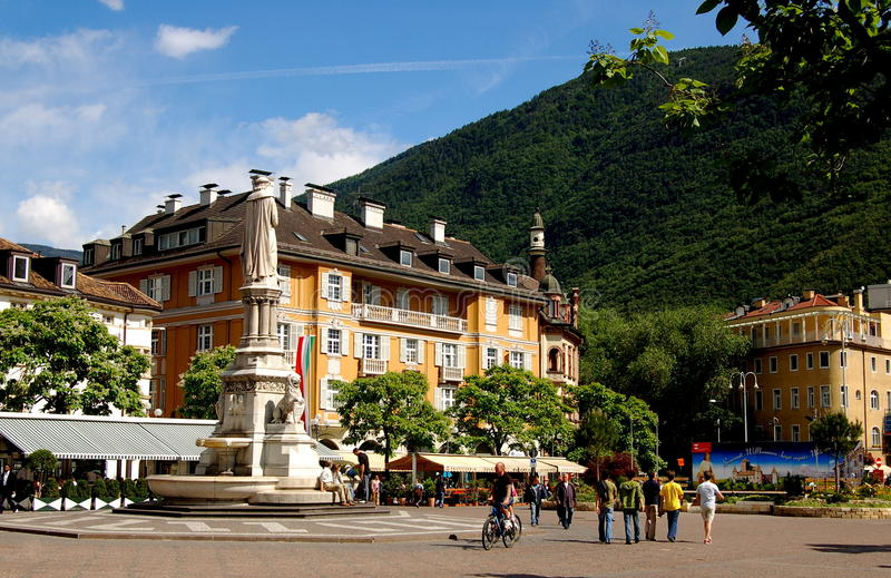 Bolzano, Italy: Piazza Valther Von Derbogelweide. Commemorative statue and fountain at the center of the gracious Piazza Valther Von Derbogelweide lined by stock photos