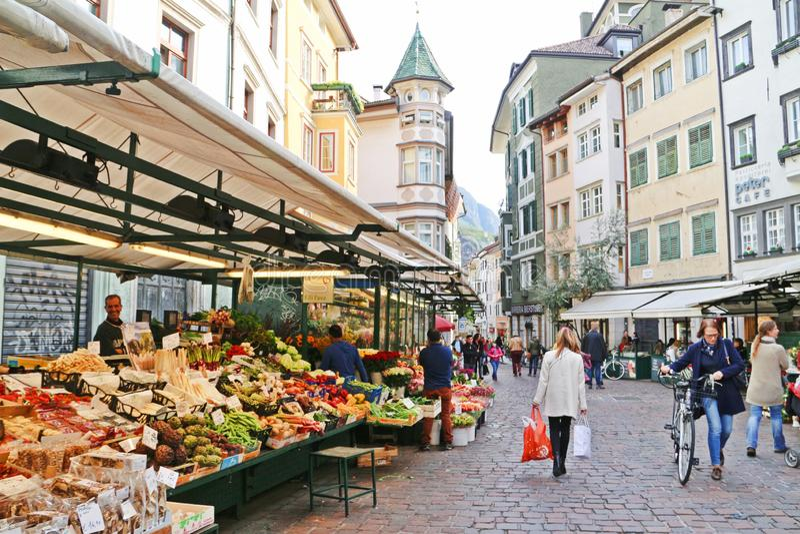 Traditional market in Bolzano, Italy. Bolzano, Italy: April 10, 2019: Street market in Bolzano, a city in south Tyrol and north of Italy. There are fresh fruits royalty free stock photo