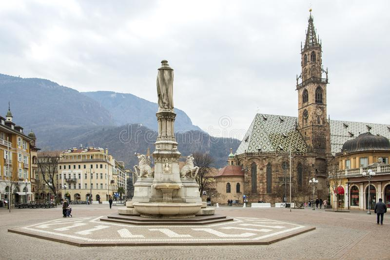 Bolzano, South Tyrol, Italy - January 27, 2019: Piazza Walther with tourists at the Monument to the poet Walther von der stock photography