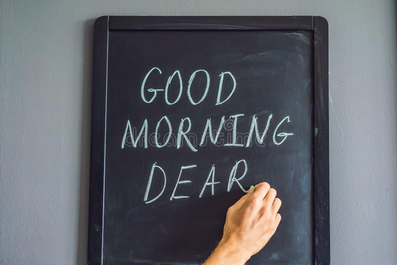 Bom dia caro - inscri??o no giz em um quadro-negro imagem de stock royalty free