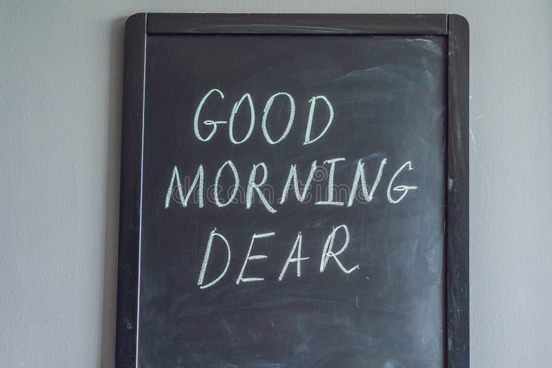 Bom dia caro - inscri??o no giz em um quadro-negro imagens de stock