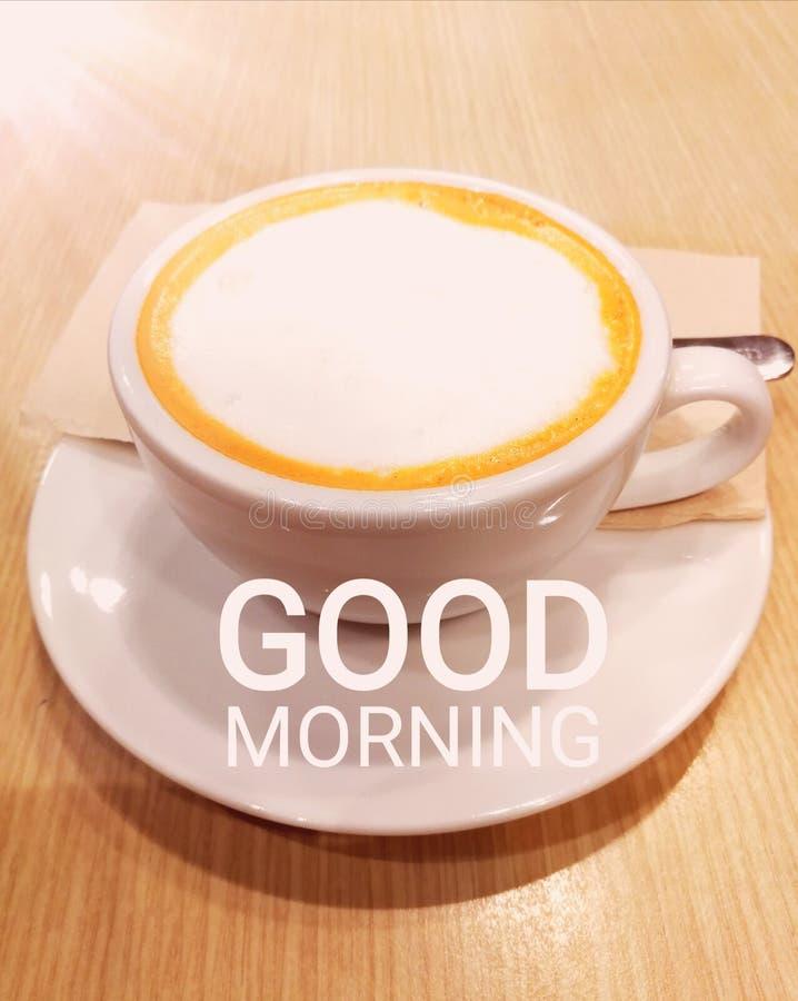 Bom dia e copo de chá fotografia de stock royalty free