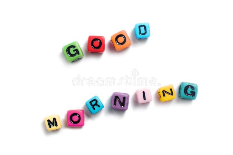 Bom dia soletrado para fora em grânulos coloridos do cubo fotos de stock royalty free
