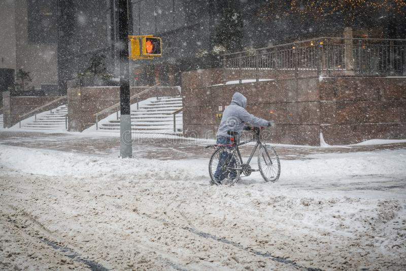 Bicycle in Snow Storm royalty free stock image