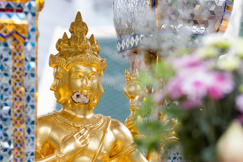 Bomb damage on Thao Maha Phrom, bomb explosion in Ratchaprasong on August 17, 2015 Bangkok, Thailand. Bomb damage on Thao Maha Phrom, the Brahma statue after royalty free stock photo