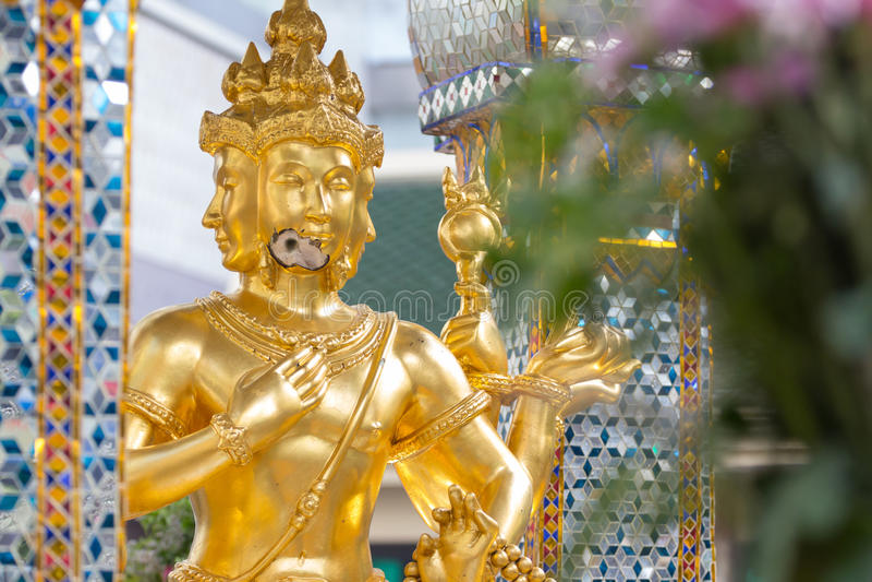 Bomb damage on Thao Maha Phrom, bomb explosion in Ratchaprasong on August 17, 2015 Bangkok, Thailand. Bomb damage on Thao Maha Phrom, the Brahma statue after stock photos