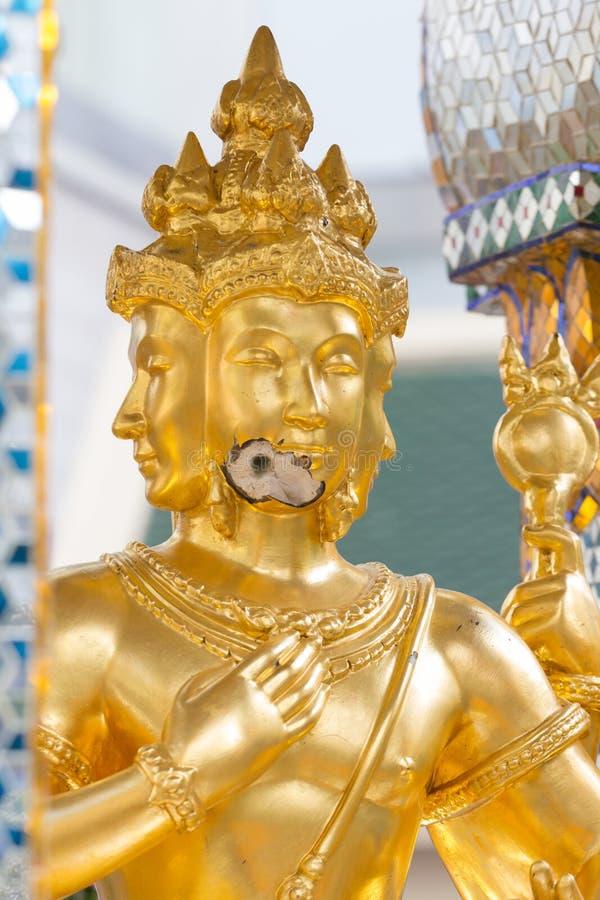 Bomb damage on Thao Maha Phrom, bomb explosion in Ratchaprasong on August 17, 2015 Bangkok, Thailand. Bomb damage on Thao Maha Phrom, the Brahma statue after stock photo