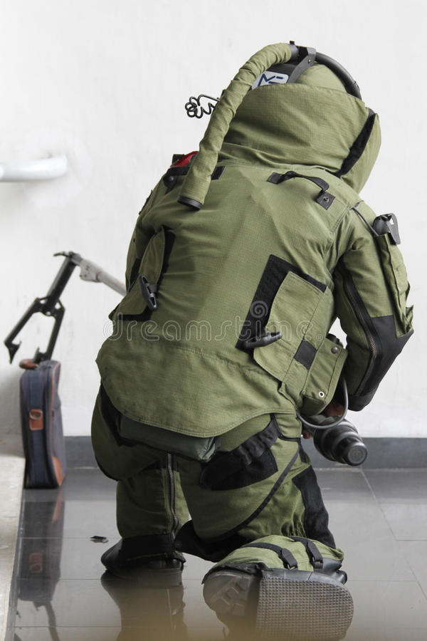 Bomb squad. Member of bomb squad assigned to defuse explosive devices in simulated security in the East Parking Senayan, Jakarta royalty free stock photography