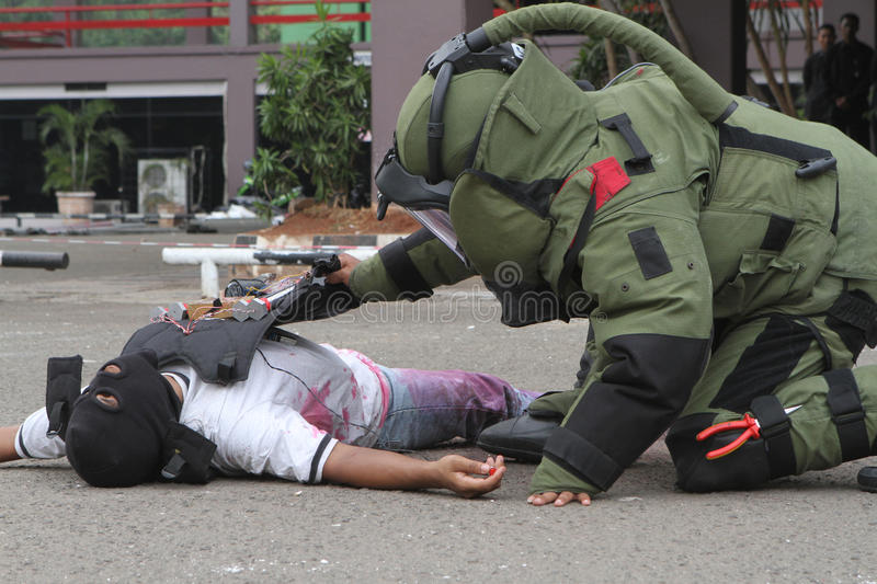 Bomb squad. Member of bomb squad crippling suicide bombings terrorist and defuse explosive devices in simulated security in the East Parking Senayan, Jakarta stock photography
