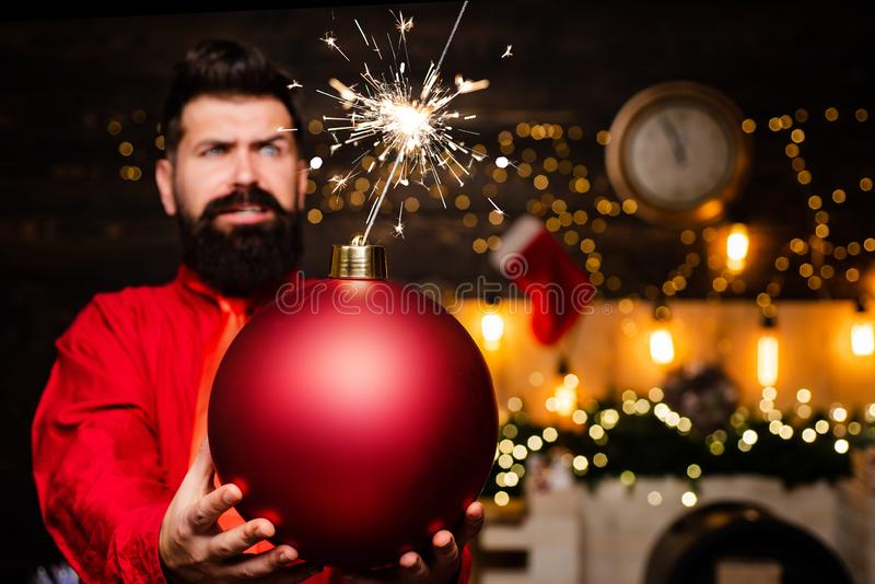 Bomb text copy space. Creative boom. Christmas Santa claus with bomb. Party Christmas. Christmas man in fashion red royalty free stock photo