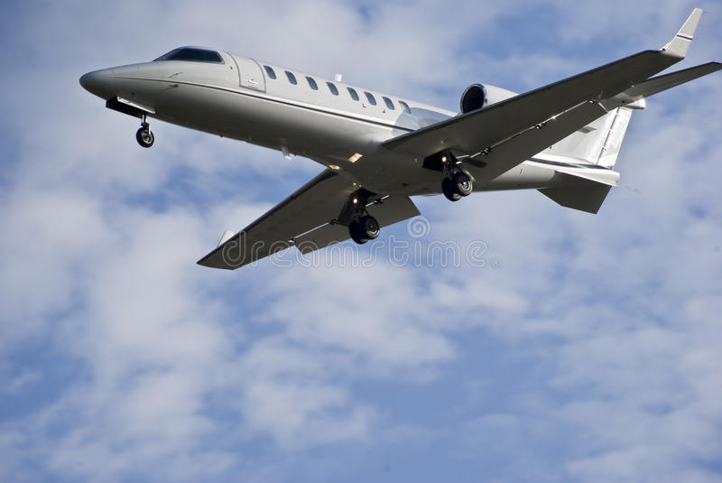 Bombardier Aerospace Learjet 45 - Business Jet. Learjet 45, business jet coming in for landing at Lanseria International Airport (FALA). Landing gear down royalty free stock photography