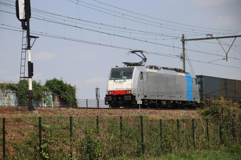 Bombardier TRAXX F140 MS locomotive with sea container freigt on the rails at Nieuwerkerk aan den IJssel in the Netherlands. Bombardier TRAXX F140 MS locomotive stock photos